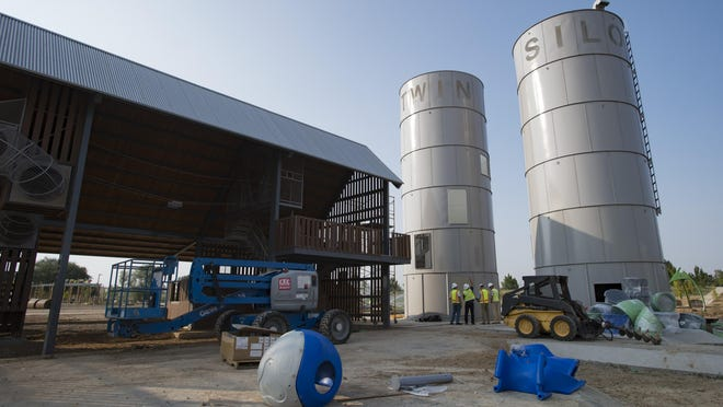 Silos stand tall as part of the play area at Twin Silo Park near Ziegler Road. The park is set to open in late October.