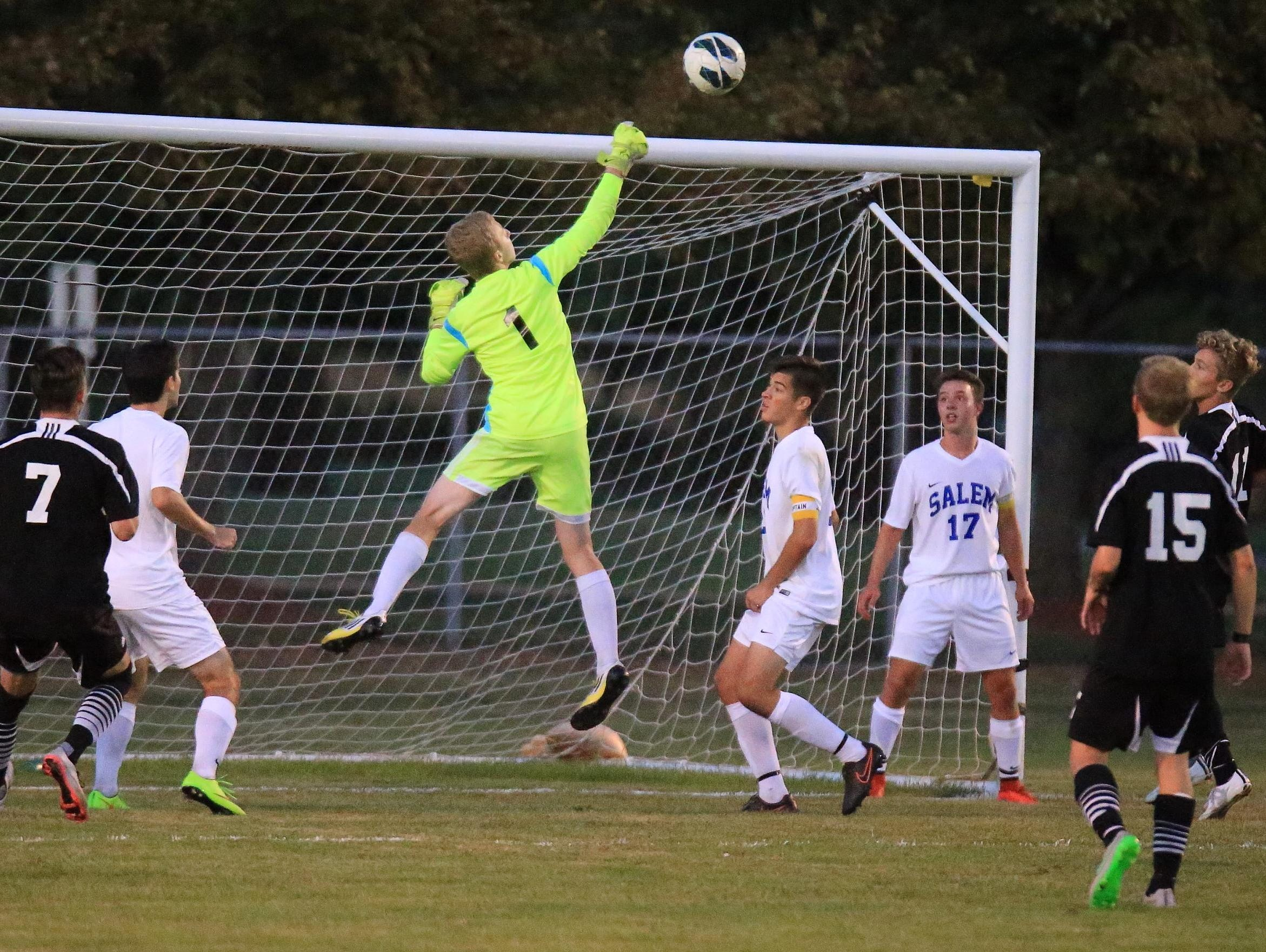 Showing some serious hops to deflect a Plymouth shot over the net is Salem goalie Karson Gregory (No. 1). Among other players pictured is Rocks midfielder Max Kummer (No. 17) and Plymouth forwards Mike Blake (No. 7) and Keaton Hegarty (No. 15).