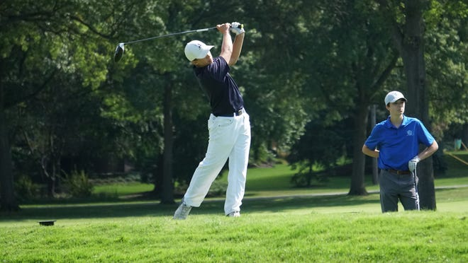 Hudson resident Coop Pamer hits a shot during a match last year.