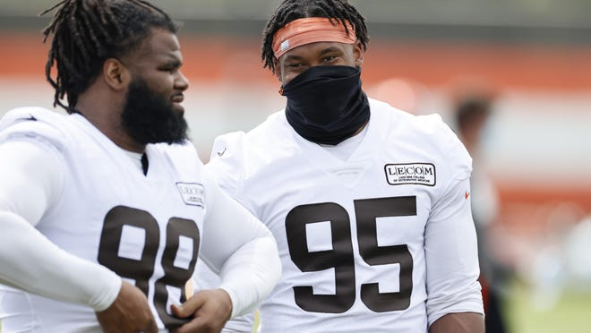 Browns defensive end Myles Garrett, right, talks with defensive tackle Sheldon Richardson during practice on Aug. 14.