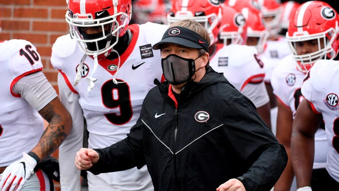 """Georgia head coach Kirby Smart is seen before the start of an NCAA college football game against Missouri Saturday, Dec. 12, 2020, in Columbia, Mo. The personal touch that helps coaches sell their programs to blue-chip prospects is missing from this year's recruiting cycle. Restrictions brought about by the coronavirus pandemic prevent face-to-face communication between players and coaches. """"It's just weird,"""" Smart said."""