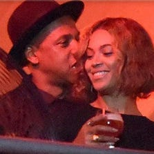 Singer Beyonce Knowles (R) and rapper Jay-Z attend American Eagle Outfitters Celebrates The Budweiser Made in America Music Festival during day 2 at Los Angeles Grand Park on August 31, 2014, in Los Angeles, California.