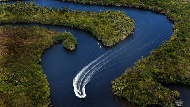 A boater cruises through the twists and turns in the north fork of the St. Lucie River in Port St. Lucie.