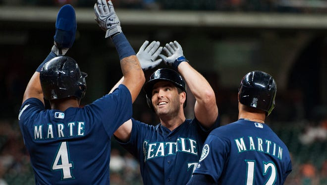 The Seattle Mariners Seth Smith (7) is congratulated by Ketel Marte (4) and Leonys Martin (12) after hitting a three-run home run against the Houston Astros in the seventh inning of a baseball game Wednesday, July 6, 2016, in Houston. (AP Photo/George Bridges)