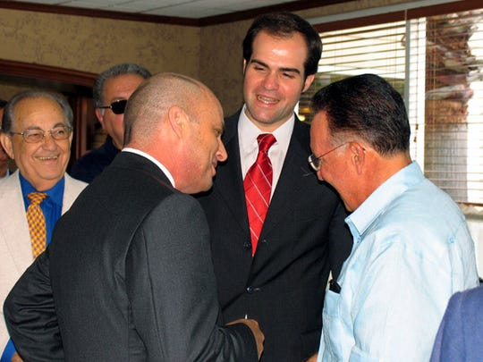 Mauricio Claver-Carone, center, is a Cuba lobbyist. To the left is Stan Barnes, the former Arizona state senator who ran in the primary against Jeff Flake in 2004.