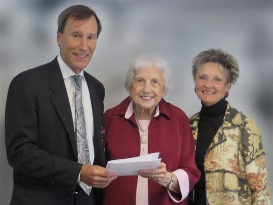 Auxiliary Co-President Greta Upham (center) presents Putnam Hospital Center President James Caldas and Foundation Executive Director Anita Minella with a $35,000 check toward Emergency Department renovations.
