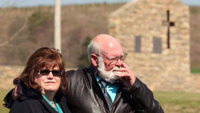 In this March 30, 2014 photo, Donald Bass stand with his wife Julie at the Goshen Memorial during a 20-year remembrance service in Piedmont, Alabama. A tornado that killed 20 people inside the Goshen United Methodist Church on March 27, 1994.