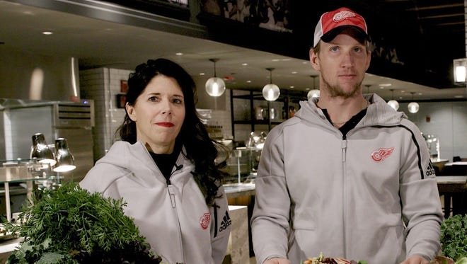 Lisa McDowell and Red Wings forward Justin Abdelkader during a recent cooking lesson.