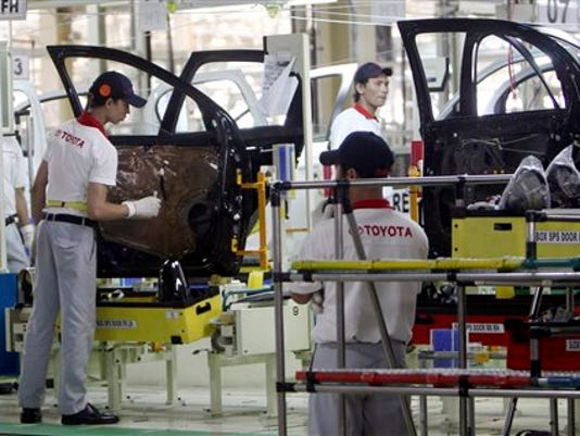 FILE - In this March 15, 2013 file photo, Indonesian workers assemble passenger cars at the new Toyota plant in Karawang, West Java, Indonesia after Toyota officially opened their second manufacturing plant in the country.