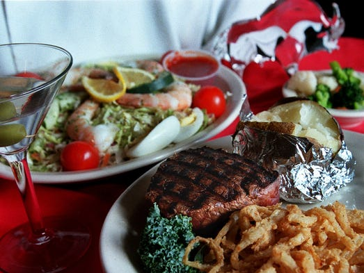 "Sept. 1999: ""Bearcat"" - Filet Mignon with baked potato and onion ..."