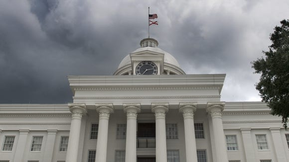 Storm clouds build over the Alabama State Capitol Building in Montgomery, Ala. on July 23, 2015.