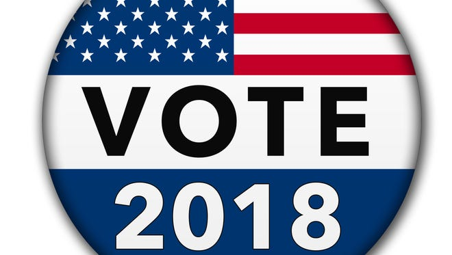 A vote button for the 2018 election season with the USA flag and drop shadow. Image is with a clipping path of the button.