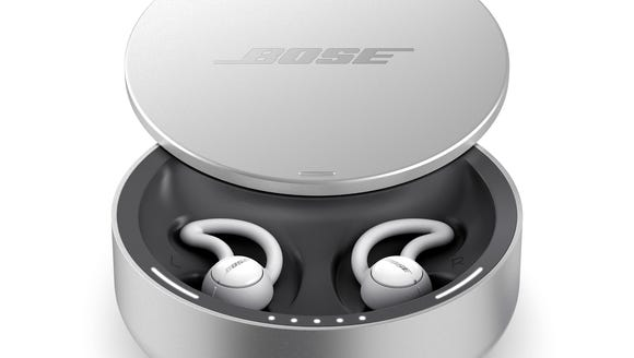 Bose Sleepbuds in their charging case.
