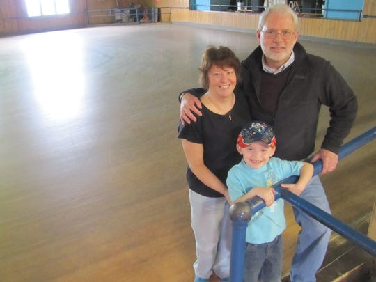 Donna Isaacs of Lowman, shown were her husband Steven Isaacs, will run Joycrest Skating Rink in Elmira following the death of her father, Thomas Sloniger of Elmira. With them is their 4-year-old grandson and skating enthusiast Braydn Hourihan, 4.