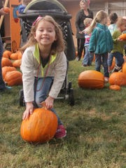 Addalyn Catey, 5 visited the Grace United Methodist Church Pumpkin Patch Thursday morning with her mother and her Bethel Baptist Tots preschool classmates. Catey played with her preschool classmates and North Elementary School students during the event.