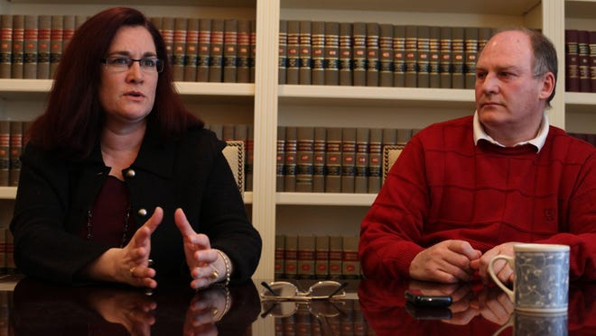 Julian and Thal Wendrow talkabout their ordeal in their lawyer's office in Bloomfield Hills, Mich., in this 2011 file photo. Julian Wendrow was falsely accused of raping his severely autistic 15-year-old daughter and Thal Wendrow was accused of failing to stop it.