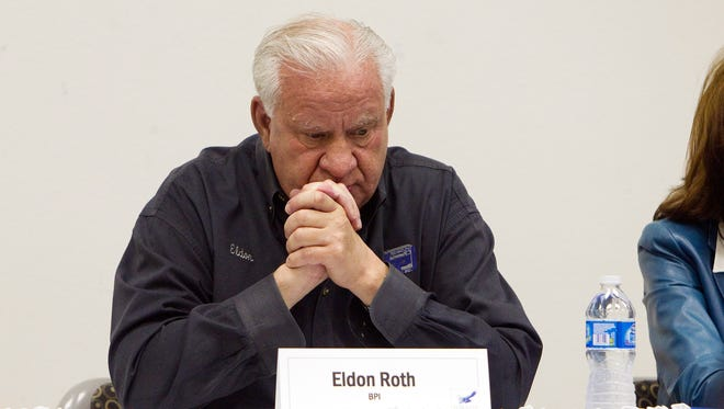 "In this 2012 photo, Eldon Roth, the CEO and founder of Beef Products Inc., listens to BPI employees in Waterloo, during the uproar over what was disparagingly called ""pink slume"" beef product. Roth spoke to Iowa Gov. Terry Branstad about concerns with the state's former worker compensation commissioner, according to documents obtained by the Associated Press."