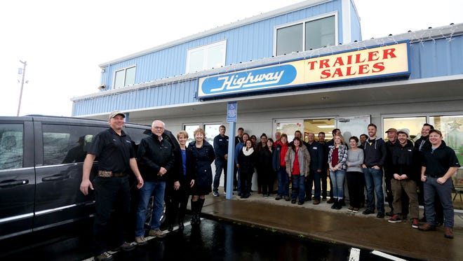 Employees of Highway Trailer Sales and Service and the Center for Hope and Safety gather next to a van being donated to Center for Hope and Safety by Highway Trailer Sales and Service after a request in the Statesman Journal Catalog of Giving at Highway Trailer Sales and Service in Salem on Friday, Dec. 18, 2015.