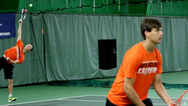 Sprague's Jonah Lovell, left, and Nate Harder compete in a doubles match in the Sprague vs. McKay boy's tennis meet at the Courthouse Tennis Center in Salem on Thursday, May 5, 2016.