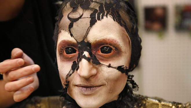 Janna Ahrndt smiles as she shows her painted face during the HorrorHound convention at the Marriott East, Saturday, Sept. 10, 2016.