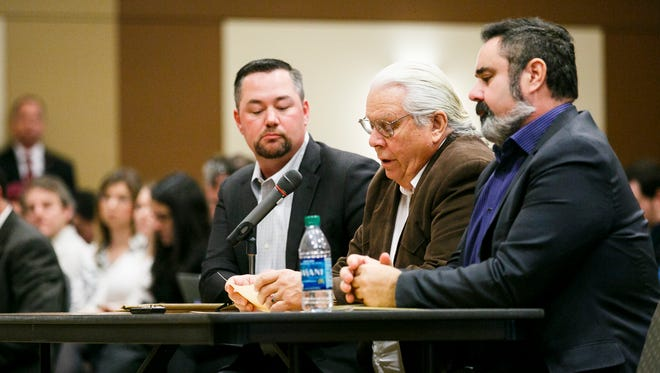 Chief Warren Brainard of the Confederated Tribes of Coos, Lower Umpqua and Siuslaw Indians, center, speaks at a public hearing with the State Lands Board concerning the sale of the Elliott State Forest on Tuesday, Dec. 13, 2016, at the Keizer Community Center. The sole bidder, Lone Rock Timber, is partnering financially with the Cow Creek Band of Umpqua Tribe of Indians, and will consult with other agencies.