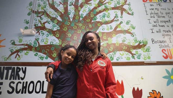 Nyema Passmore a fourth grader at Burns Elementary school with her City Year mentor Kristian Rice Friday, June 9, 2017 at Burns Elementary in Detroit, MI.