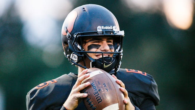 Sprague quarterback Spencer Plant (5) warms up before a game against McMinnville on Friday, Sept. 22, 2017, at Sprague High School. Sprague won the game 47-7.