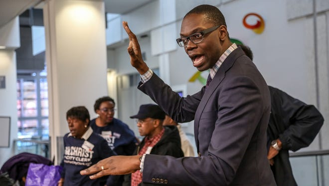 Garlin Gilchrist, who lost his election for Detroit City Clerk, talks to volunteers before the Board of County Canvassers for Wayne County meeting at Cobo Center in Detroit in December 2017.