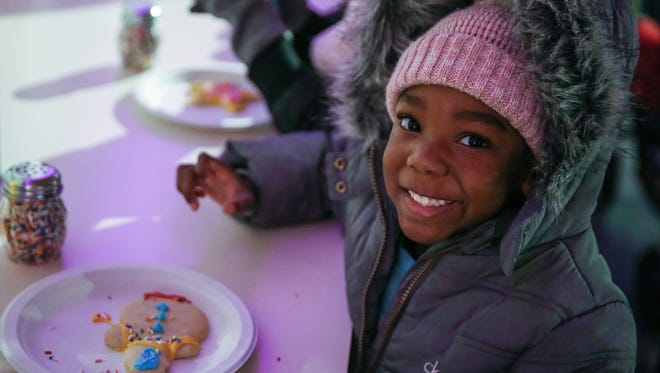 Charlii Johnson, 4, smiles after decorating a snowman cookie during Indianapolis Zoo's Christmas at the Zoo, Wednesday, Dec. 6, 2017.