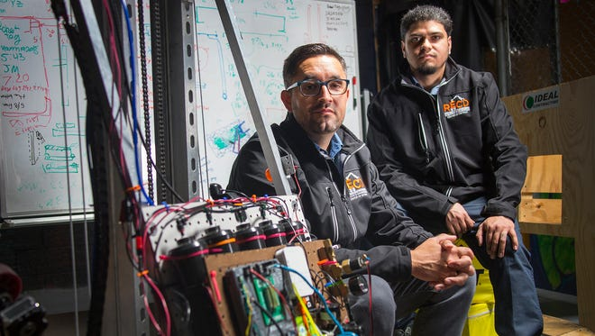 Chairman of the Board of the Robotics and Engineering Center of Detroit Joaquin Nuno-Whelan, 40, of Ann Arbor, left, and robotics coordinator Jonathan Rodriguez, 33, of Detroit pose for a portrait at the Detroit Hispanic Development Corporation in Detroit on Friday April 6, 2018, in the lab they facilitate to teach at risk students about robotics and engineering.