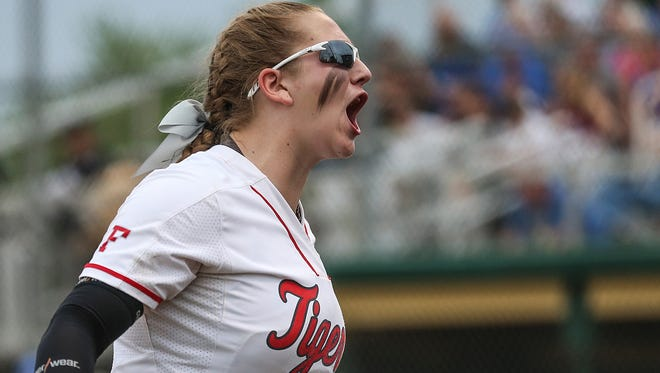 Fishers Tiger Hannah Mays (10) celebrates after Fishers quickly closed the top of the third inning with no runs by the Royals, during softball sectionals at Westfield High School in Westfield, Ind., Monday, May 21, 2018. Fishers defeated Hamilton Southeastern, 4-3.