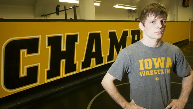Iowa sophomore Cory Clark poses for a photo during Iowa wrestling media day at Carver-Hawkeye Arena.