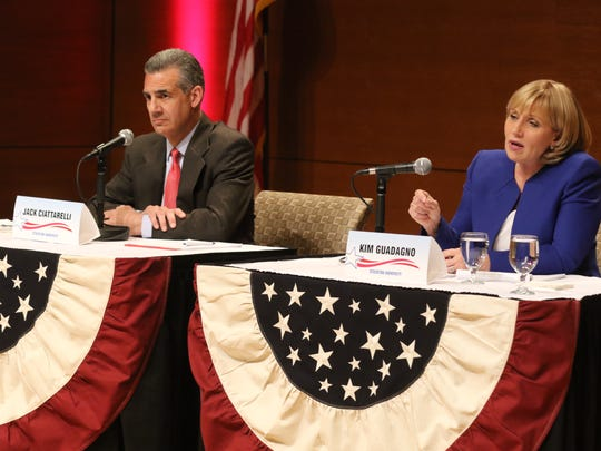 Republican gubernatorial candidate Jack Ciattarelli  as fellow candidate Kim Guadagno answers a debate question.