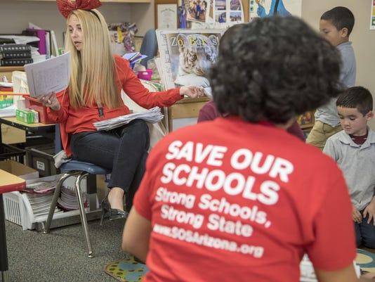 Teachers wear red to protest low teacher pay