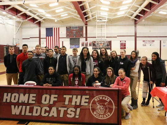 Jordan Dartis, seated left, and Kym Royster, seated second from left, signed their national letters of intent. Dartis is going to Ohio U., while Royster is going to Indiana U.
