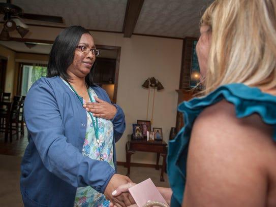 A surprised Mashanda Norwood, left, of Jackson, reacts