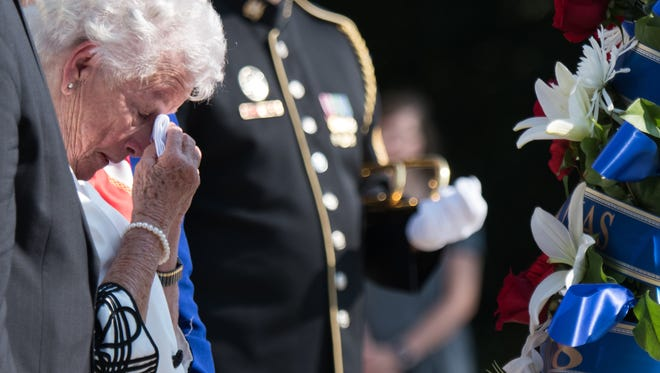 Ms. Irene Sgambelluri, Survivor of the Japanese occupation of Guam, reacts after placeing a wreath during an Army Full Honors Wreath Laying Ceremony at the Tomb of the Unknown Soldier in Arlington National Cemetery, Arlington, Va.; July 16, 2018. The Wreath Laying Ceremony at the Tomb of the Unknown Soldier in commemoration of the 74th Anniversary of the Liberation of Guam and the Battle for the Northern Mariana Islands. (DoD Photo by U.S. Army Sgt. James K. McCann)