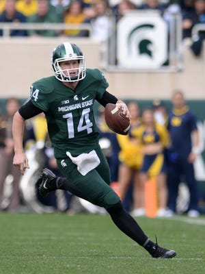 Brian Lewerke runs the ball down the field during the game against Michigan on Saturday, Oct. 29, 2016 at Spartan Stadium in East Lansing.