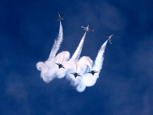 The Blue Angels perform for the crowd Saturday during