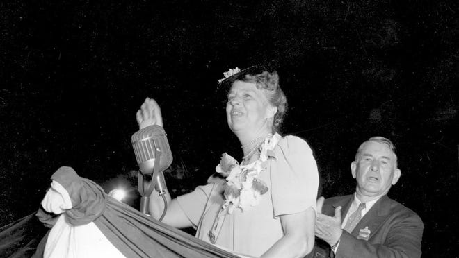 U.S. First Lady Eleanor Roosevelt waves as she acknowledges a standing ovation after she addressed the Democratic National Convention on July 18, 1940, in Chicago. The DNC chairman Alben W. Barkley stands behind her. Roosevelt is the first wife of a president to address a national political convention.