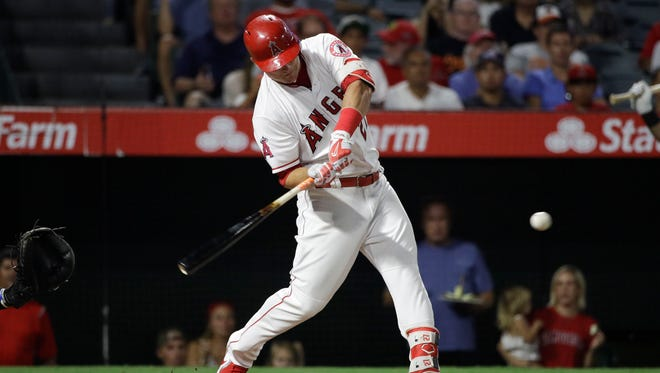 Los Angeles Angels outfielder Mike Trout hits a double, the 1,000th hit of his career, during Monday's loss to the Orioles.