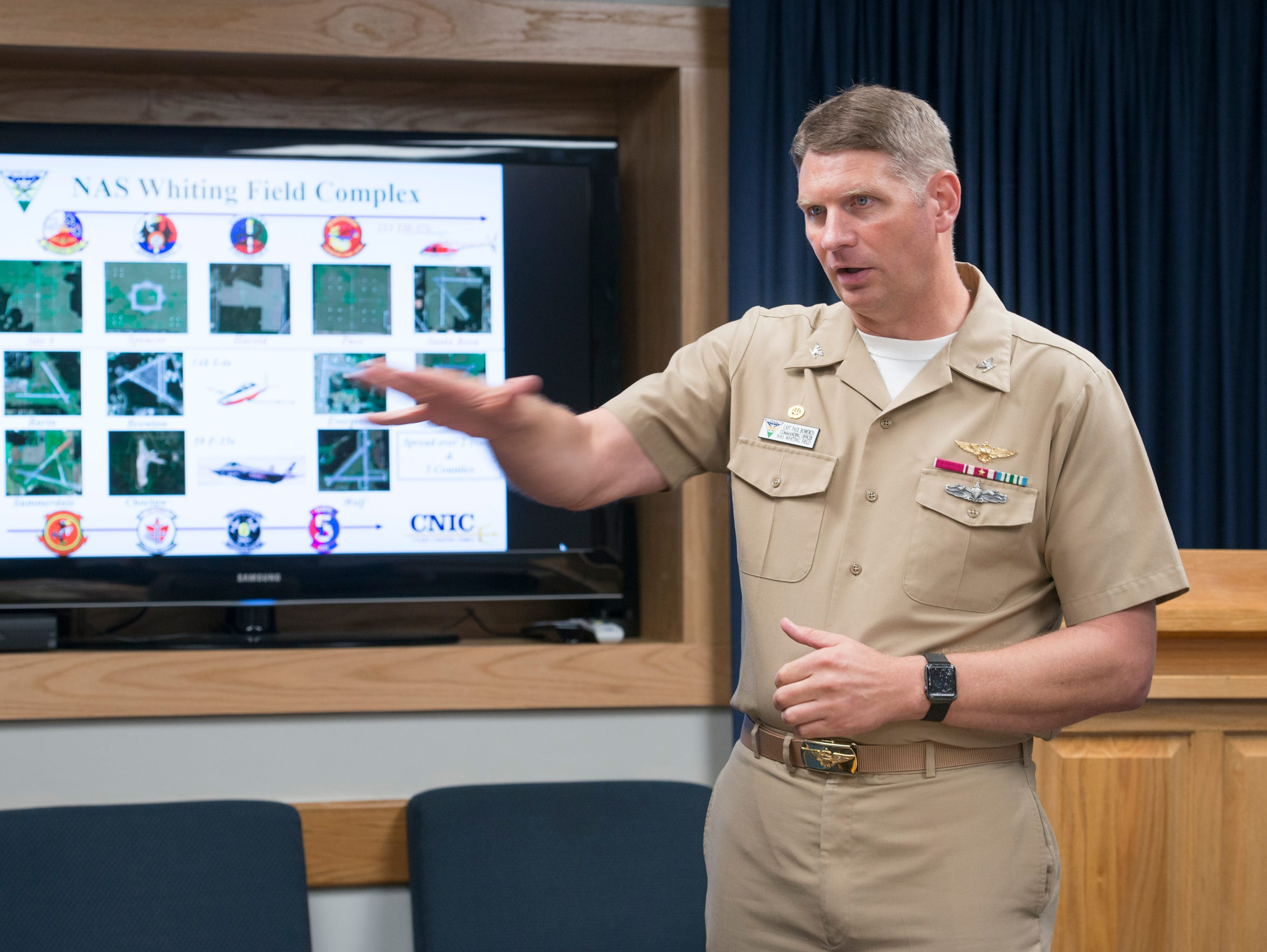 Capt. Paul Bowdich, the commanding officer of Whiting Field, talks June 14 about the mission of the naval air station.
