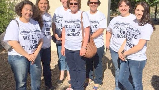 Folks were proud of their We Love Our Coaches T-shirts at the Silver School Board special meeting held Thursday, May 26. From left are Christina Trewern, Perla Castillo, Heather Holguin, Sheila Topmiller, Jewel Eva Jackson, Lisa Trewern and Haley Trewern