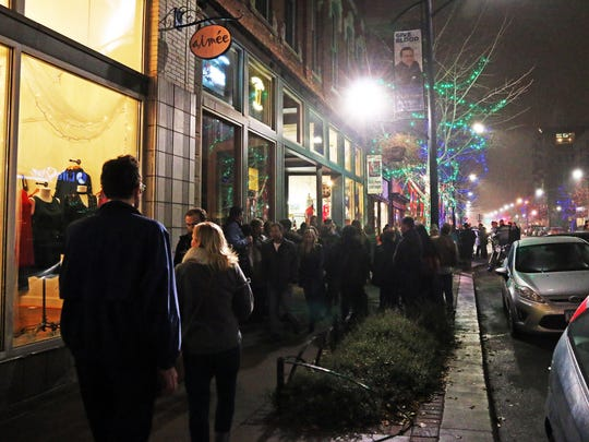 The sidewalks are crowded during the 16th annual Holiday Promenade in the Historic East Village of Des Moines on Friday, Nov. 17, 2017.  The festive event features boutique shopping, free ice skating at the Brenton Skating Plaza, caroling, tree lighting, a visit from Santa, live ice sculpting, and free horse-drawn trolley rides.
