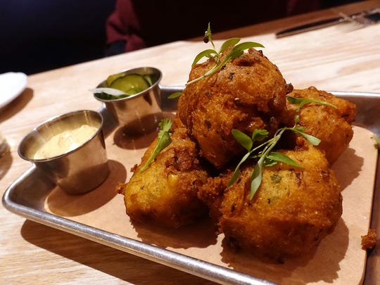 Blue crab hushpuppies with Creole aioli and pickles