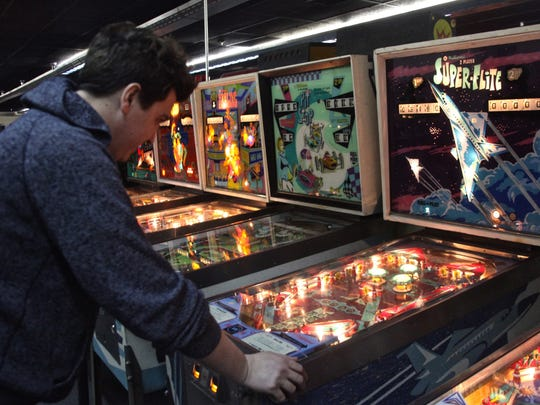 "Johnathon Weeks, owner of the Museum of Pinball, plays on a pinball machine entitled ""Super-Flite"" on Thursday, Jan. 28, 2016."