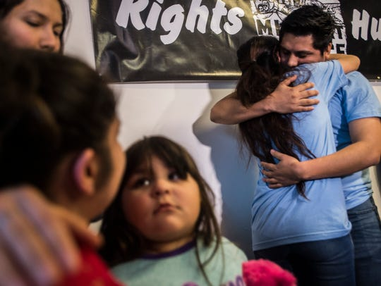 Right, Zully Palacios is embraced by Enrique Balcazar at a news conference at the Vermont Workers Center in Burlington, Vt., on Tuesday night, March 28, 2017, after they were released on bail. Both were arrested by ICE along with Alex Carillo.