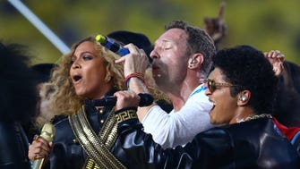 Recording artists Beyonce, left, Chris Martin of Coldplay and Bruno Mars perform during halftime at Super Bowl 50 at Levi's Stadium.