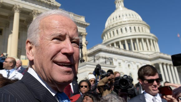 Former vice president Joe Biden pauses as he greets