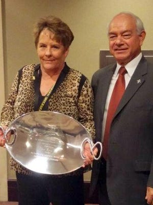 Ruidoso Village Manager Debi Lee accepts the Joe Guillen Award. At right is Guillen, a retired public servant fro whom the award is named.